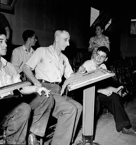 Workmen of the Polymer Corporation Limited plant enjoy a game of bowling in the plant bowling alleys